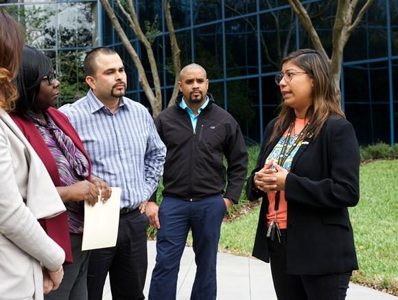 Karen Caudillo, far right, speaks to Sen. Bill Nelson's staff. - PHOTO BY MONIVETTE CORDEIRO