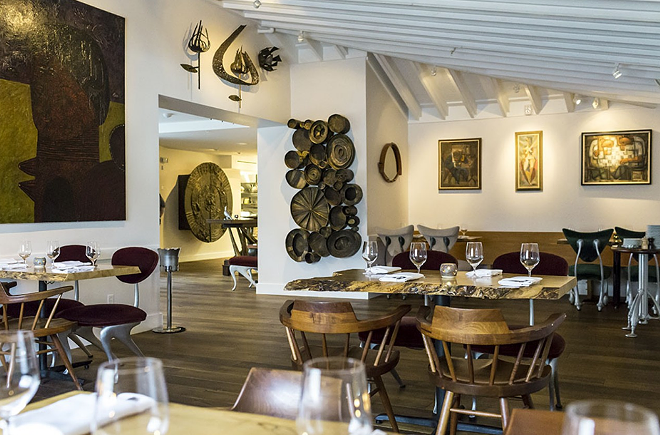 The dining room at 1921 by Norman Van Aken is full of eclectic art collected by the chef. - ROB BARTLETT