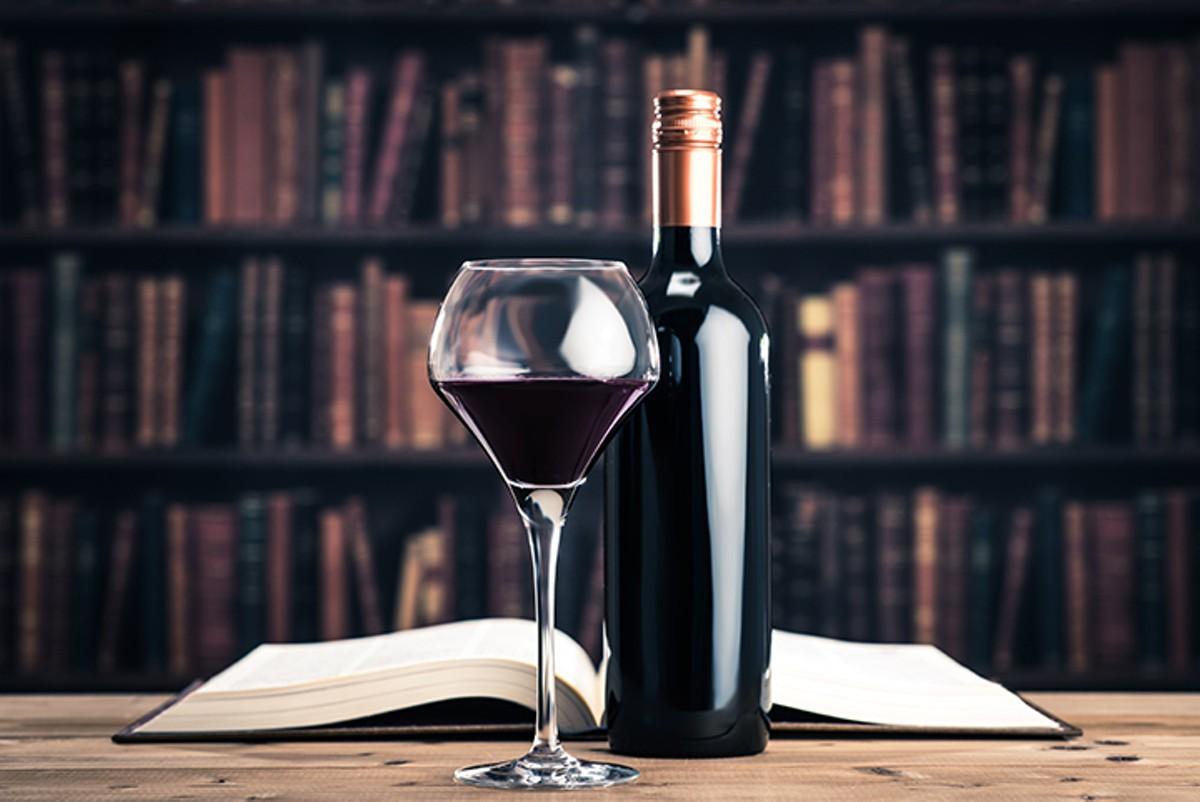 gal_drink_reading_between_the_wines_shutterstock_414419320.jpg