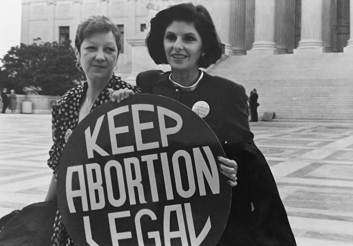 Norma McCorvey (aka Jane Roe) and lawyer Gloria Allred in front of the Supreme Court