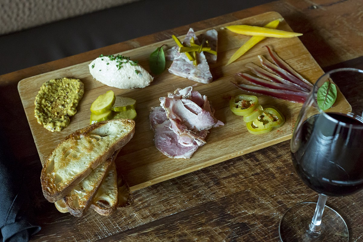 DeVine's charcuterie plate includes a selection of house-cured meats and house-pickled vegetables