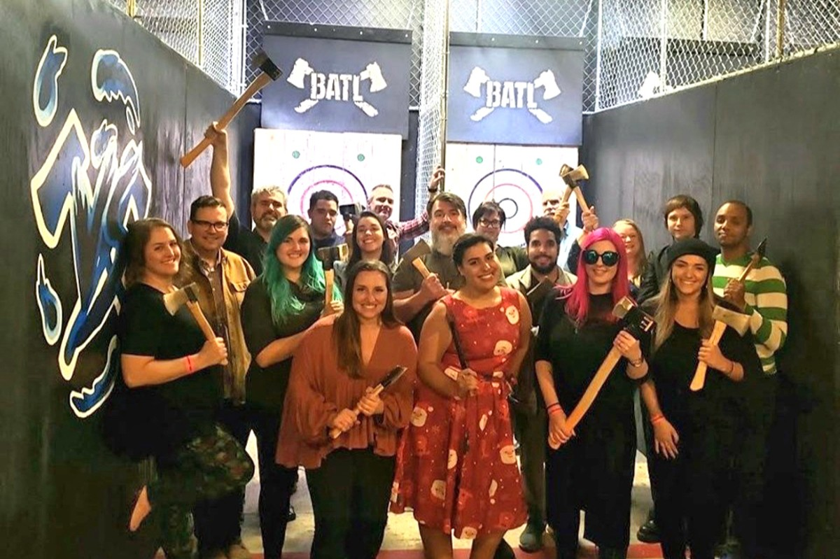 A happier, larger Orlando Weekly staff at last year's holiday party. Actually, throwing axes might be a great stress reliever right now ...