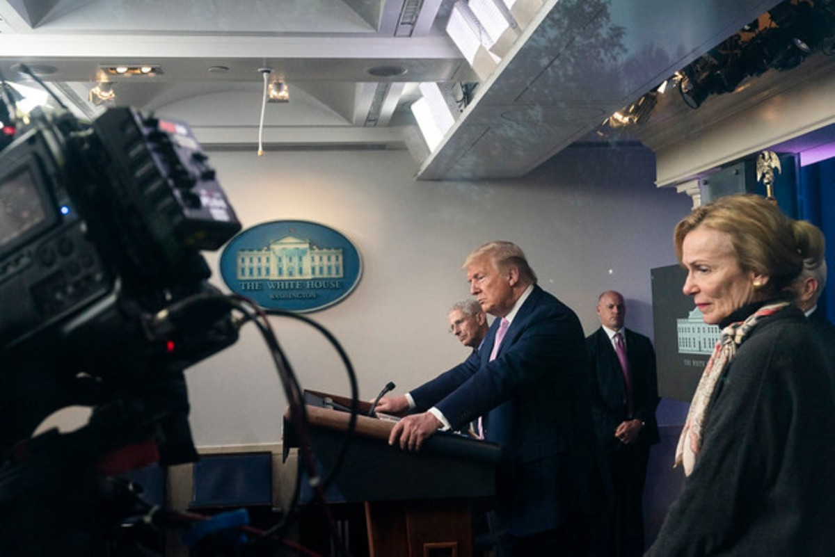 President Donald J. Trump is seen through the window taking questions from the press during a coronavirus update briefing Wednesday, April 1, 2020, in the James S. Brady Press Briefing Room of the White House.