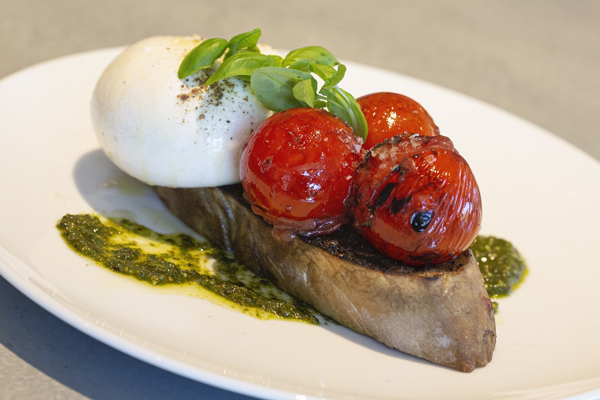 Burrata, pesto and charred tomatoes on grilled ciabatta
