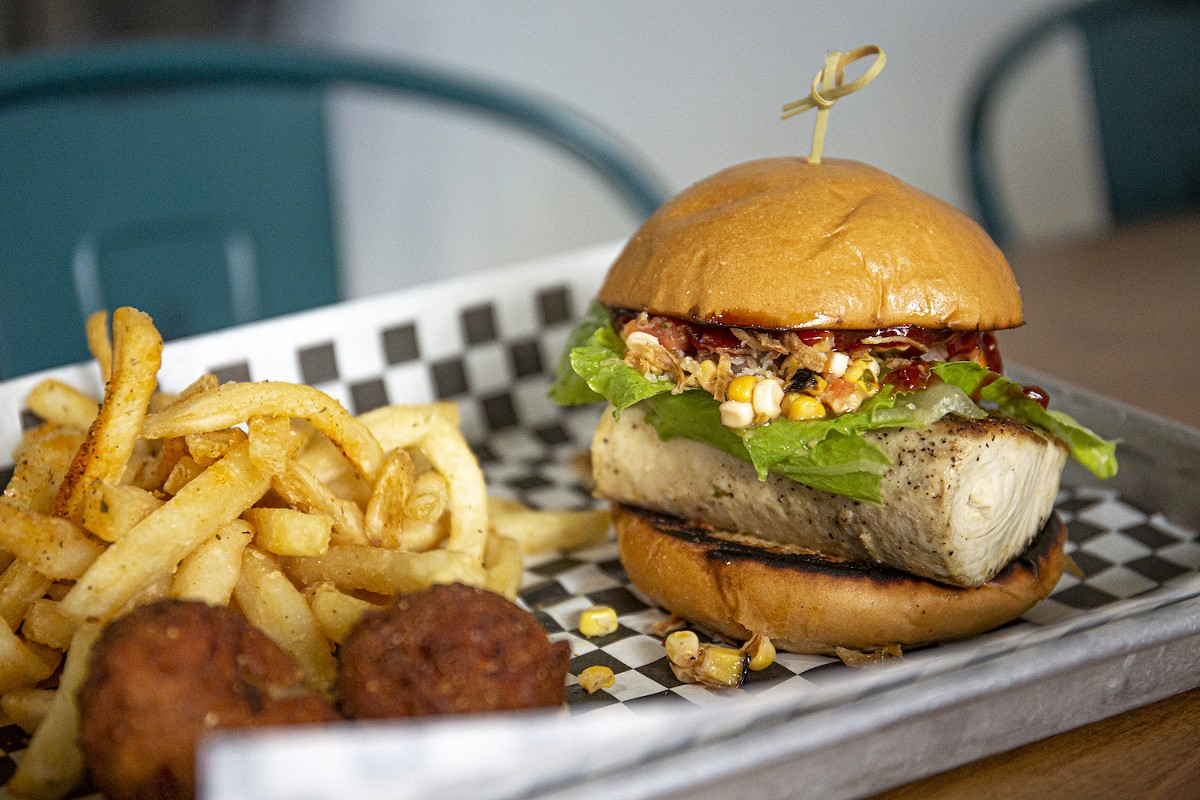 Caribbean mahi sandwich with roasted corn salsa and citrus barbecue sauce