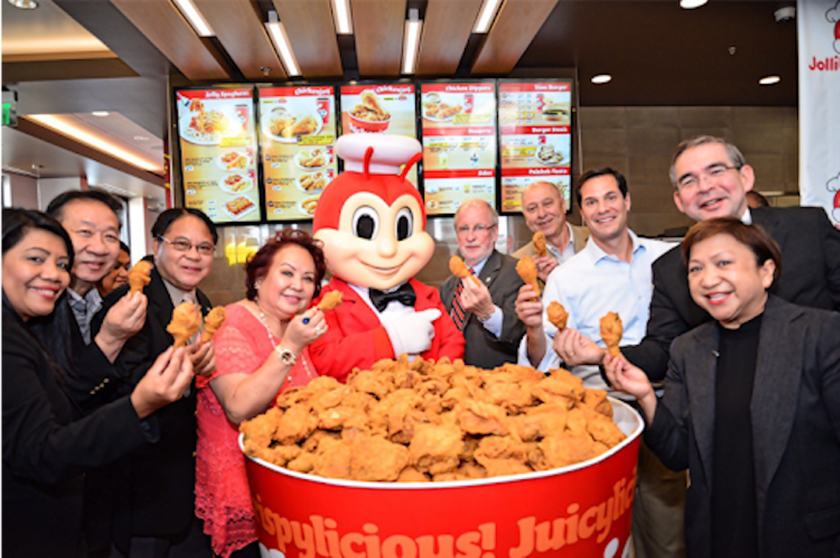 A giant bucket of chicken for a Chickenjoy toast at a Jollibee USA opening in 2016
