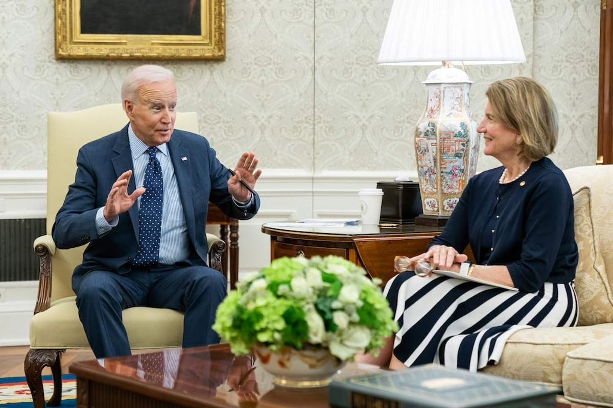 President Joe Biden and Sen. Shelley Moore Capito, R-West Virginia, meet in the Oval Office to discuss passing the infrastructure bill
