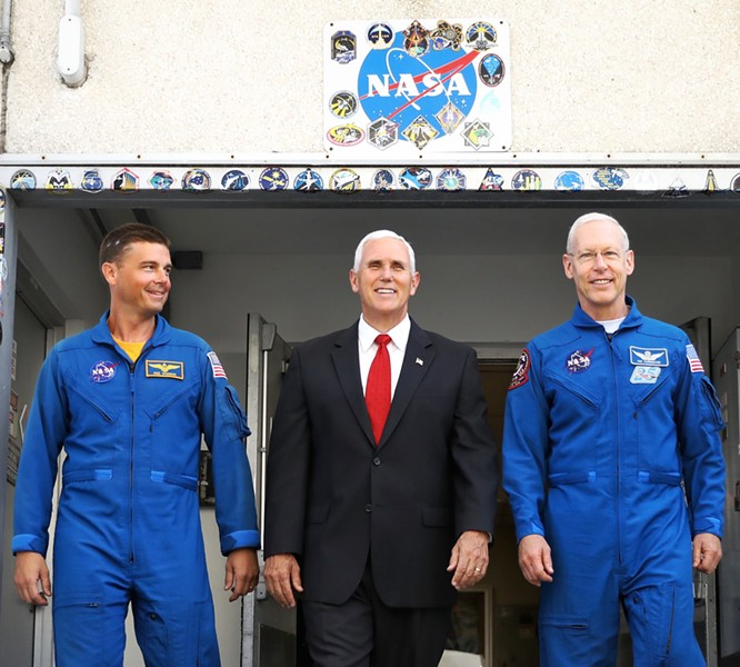 Mike Pence leaves a tour of NASA's Operations and Checkout Building in Cape Canaveral with NASA astronauts Reid Wiseman (left) and Pat Forrester on July 6 2017. - PHOTO BY JOEY ROULETTE