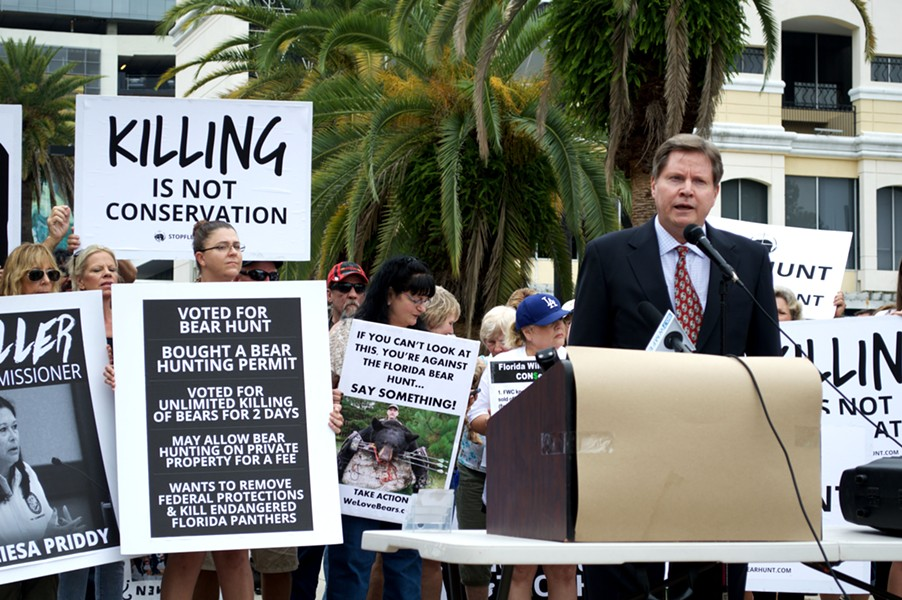 Chuck O'Neal, a member of Speak Up Wekiva who helped file a lawsuit against the Florida Fish & Wildlife Conservation Commission to stop the bear hunt, speaks at a rally on Sept. 24.
