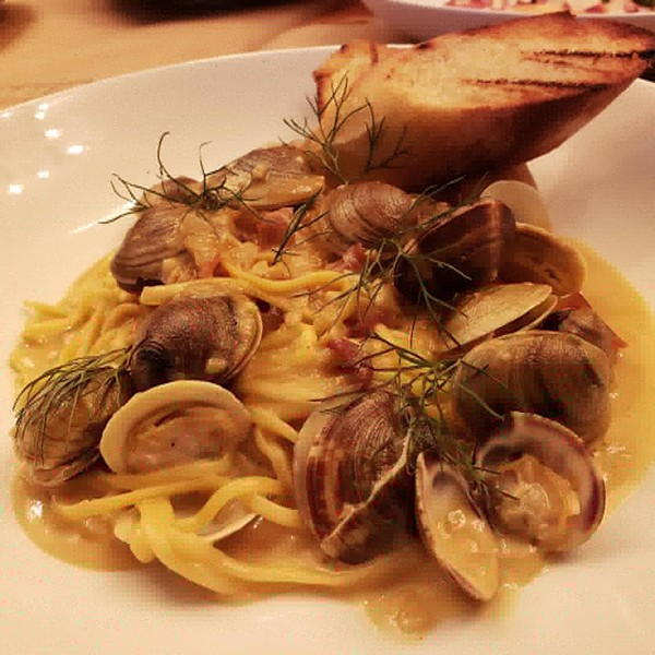 Clam linguine with littleneck clams, pancetta, fennel and lemon-white wine sauce. - HOLLY V. KAPHERR