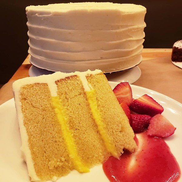 Lemon olive-oil cake with rosemary lemon curd and lemon mascarpone buttercream. I'll be having this cake for my birthday from now until I no longer have birthdays. - HOLLY V. KAPHERR