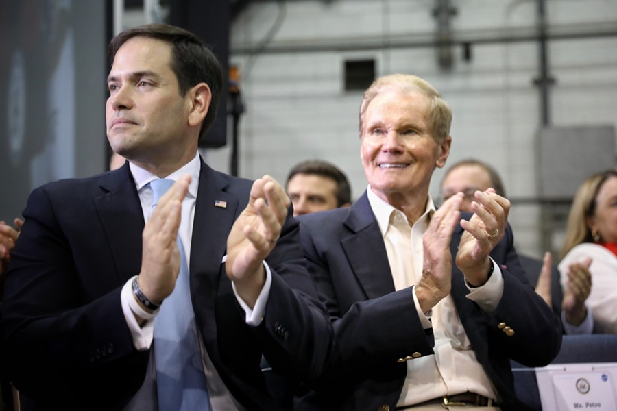 Sens. Bill Nelson and Marco Rubio applaud during a speech from Vice President Mike Pence at the Kennedy Space Center, Florida in 2017. - PHOTO BY JOEY ROULETTE