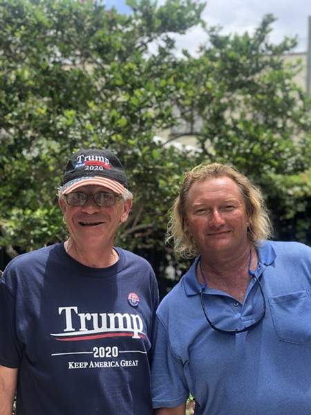 David Fraleigh, 59, and Gary Wayne Beck, 48, pose on Division Avenue while in line the day before President's Trump 2020 re-election announcement. - PHOTO BY CHRISTIAN CASALE