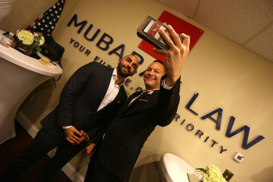 Nayef Mubarak, left, poses with Florida Rep. Carlos Guillermo Smith. - PHOTO BY JOEY ROULETTE