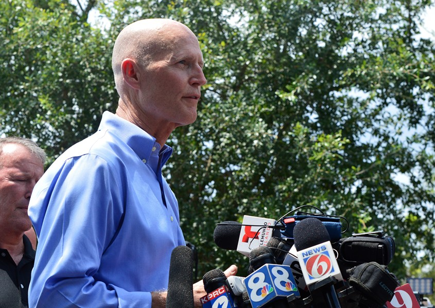 Gov. Rick Scott talks to the press regarding mass shooting at Orlando's Pulse nightclub. - PHOTO BY MONIVETTE CORDEIRO