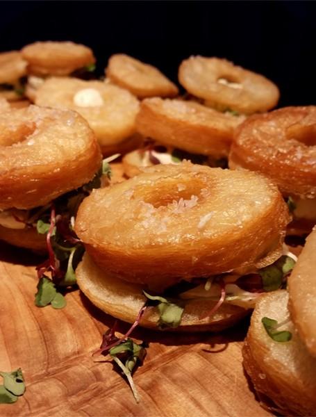 Croissant doughnut, whipped herbed cream cheese, sea salt