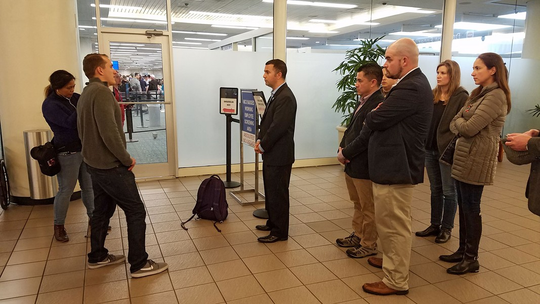 2:37 p.m.: Rep. Soto gives updates to news media, in front of immigration attorneys Henry Lim, Maud Poudat, Juan de la Torre, Milena Portillo and district director Alex Barrio. - DAVE PLOTKIN