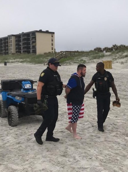 Two Jacksonville Beach Police officers arrest Mario Matthew Gatti on Saturday - PHOTO VIA JAXBEACHPD/TWITTER