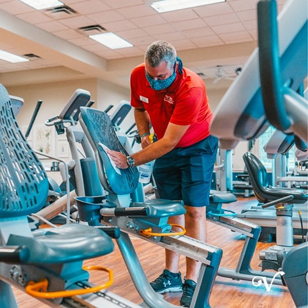 A worker in the Villages cleans exercise equipment on June 1 - PHOTO VIA THE VILLAGES/FACEBOOK