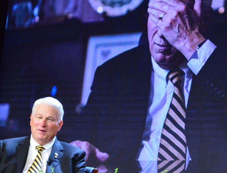 UCF President John C. Hitt discusses campus achievements on stage in the Student Union during the celebration of his 25th anniversary as President on March 1, 2017. - PHOTO BY JOEY ROULETTE