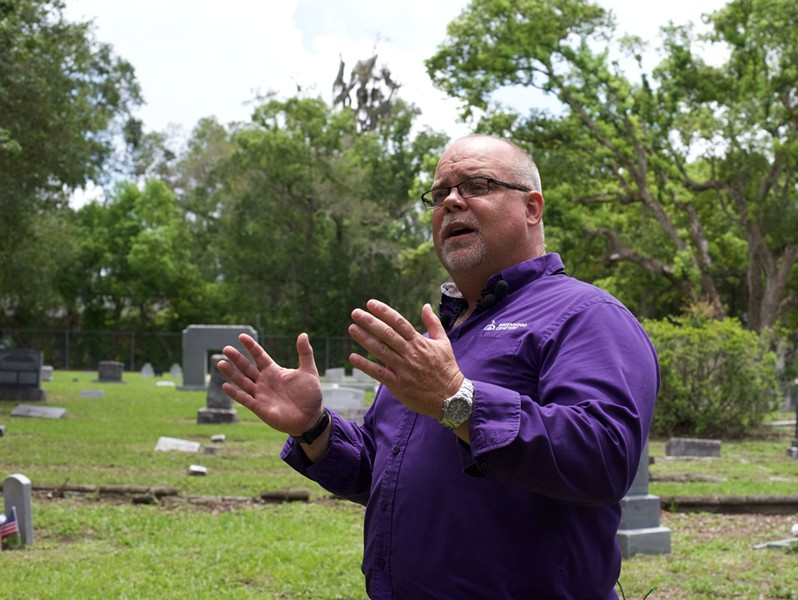 Greenwood Cemetery sexton Don Price stands in the Confederate veterans section where the statue will eventually be relocated. - PHOTO BY MONIVETTE CORDEIRO
