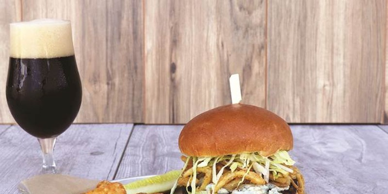 The World of Beer's new Black n' Bleu burger is free to COVID-19 vaccinated patrons on April 7.