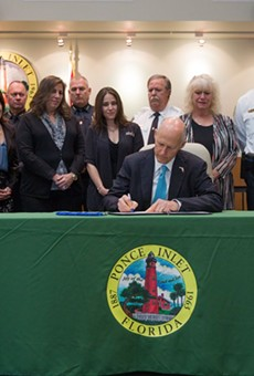 Gov. Rick Scott signs animal-abuse law named after puppy from Ponce Inlet