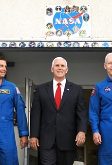 Mike Pence leaves a tour of NASA's Operations and Checkout Building in Cape Canaveral with NASA astronauts Reid Wiseman (left) and Pat Forrester on July 6 2017.