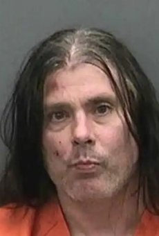Cannibal Corpse guitarist arrested for 'running toward an officer with a knife' as his Florida home burns down