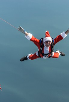 Watch a mass of skydiving Santas jump from planes onto Cocoa Beach this weekend