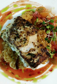A plate from Cress: Cape Canaveral golden tilefish, watermelon & Gulf shrimp risotto, SunGold tomato & ghost pepper-kissed salsa fresca, red pepper & basil gastrique.