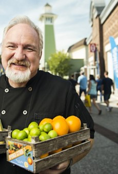 Chef Art Smith poses with fresh Florida produce to announce his farm-to-fork restaurant, Homecoming: Florida Kitchen and Southern Shine, opening summer 2016 at Disney Springs.