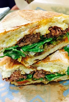 Pepito with braised beef short rib, artisan jack cheese, picked jalapeños and arugula.