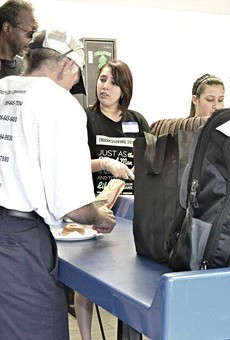 Street Team Movement volunteers assist homeless clients with laundry.