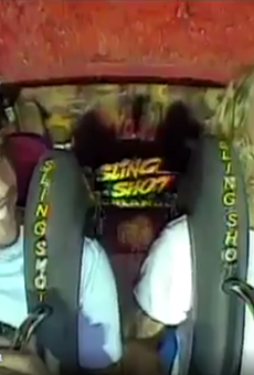Orlando City players Kaká and Brek Shea ride the Orlando Slingshot