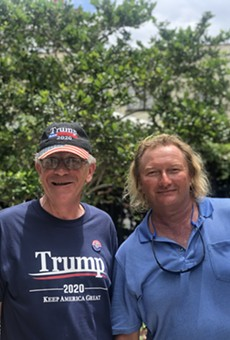 David Fraleigh, 59, and Gary Wayne Beck, 48, pose on Division Avenue while in line the day before President's Trump 2020 re-election announcement.