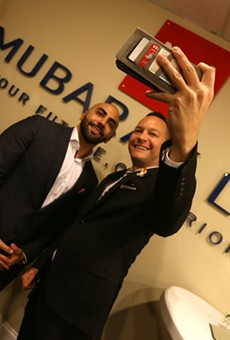 Nayef Mubarak, left, poses with Florida Rep. Carlos Guillermo Smith.