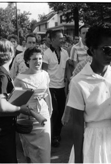 Elizabeth Eckford, 15, tries to enter Little Rock Central High School, Arkansas, in 1957 as she's pursued by a mob.