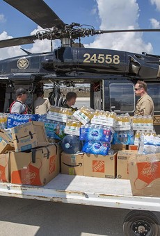 CBP AMO agents deliver food and water to Fox Town on the Abaco Islands in the Bahamas, Sept. 6 2019.