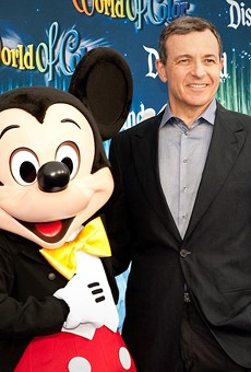 Disney CEO Bob Iger with a Disney employee in costume
