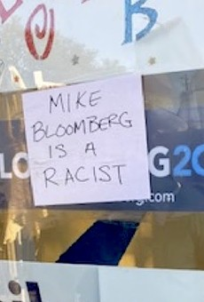 Mike Bloomberg a 'racist' and 'sexual predator,' according to signs stuck to his Florida campaign office windows