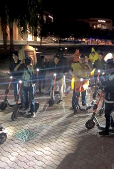 "Dozens of UCF students gather every Friday night at 9 p.m. to ride around campus as ""Spin Squad,"" a social group that formed recently due to the new scooters on campus."