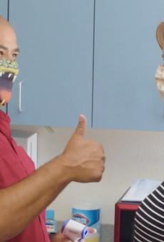 Gatorland's public safety preparedness video shows employee temperature checks
