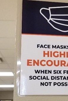 A sign at Eccleston Elementary School says masks are recommended, not required.