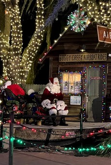 Santa and his sleigh at Jolly Creek's festival village