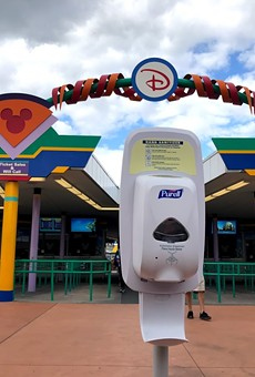 Hand sanitizer station placed at Walt Disney World's Transportation and Ticket Center.