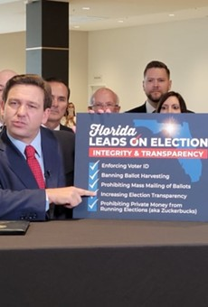 Florida Gov. Ron DeSantis signs bill restricting voting by mail into law as opponents prepare legal challenges