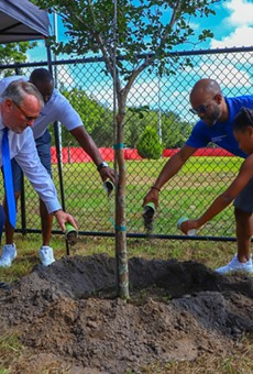 Orlando Mayor Buddy Dyer and District 6 City Commissioner Bakari F. Burns at the inauguration of Grand Avenue Park.