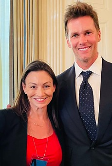 Florida's only statewide elected Democrat is facing criticism for posing with Tom Brady.