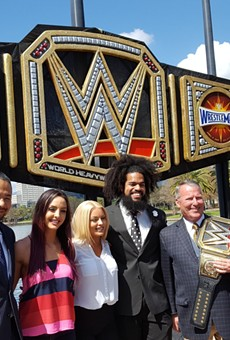 Mayor Buddy Dyer unveils giant WrestleMania title belt at Lake Eola